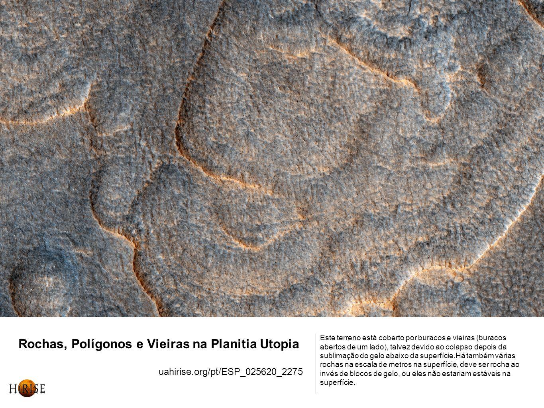 Rochas, Polígonos e Vieiras na Planitia Utopia uahirise.org/pt/ESP_025620_2275 Este terreno está coberto por buracos e vieiras (buracos abertos de um