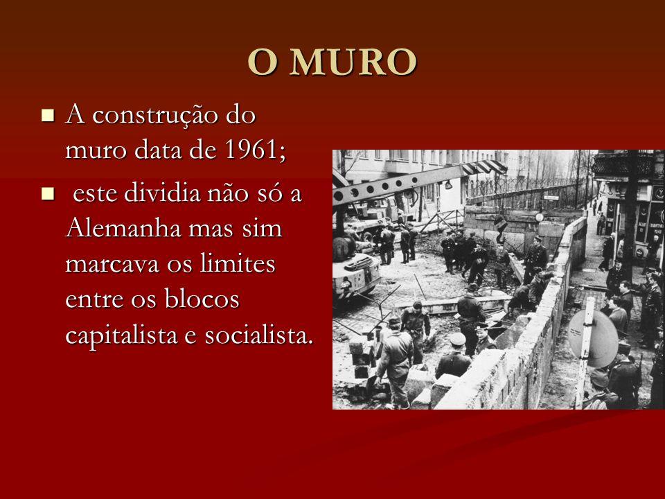 O MURO A construção do muro data de 1961; A construção do muro data de 1961; este dividia não só a Alemanha mas sim marcava os limites entre os blocos capitalista e socialista.