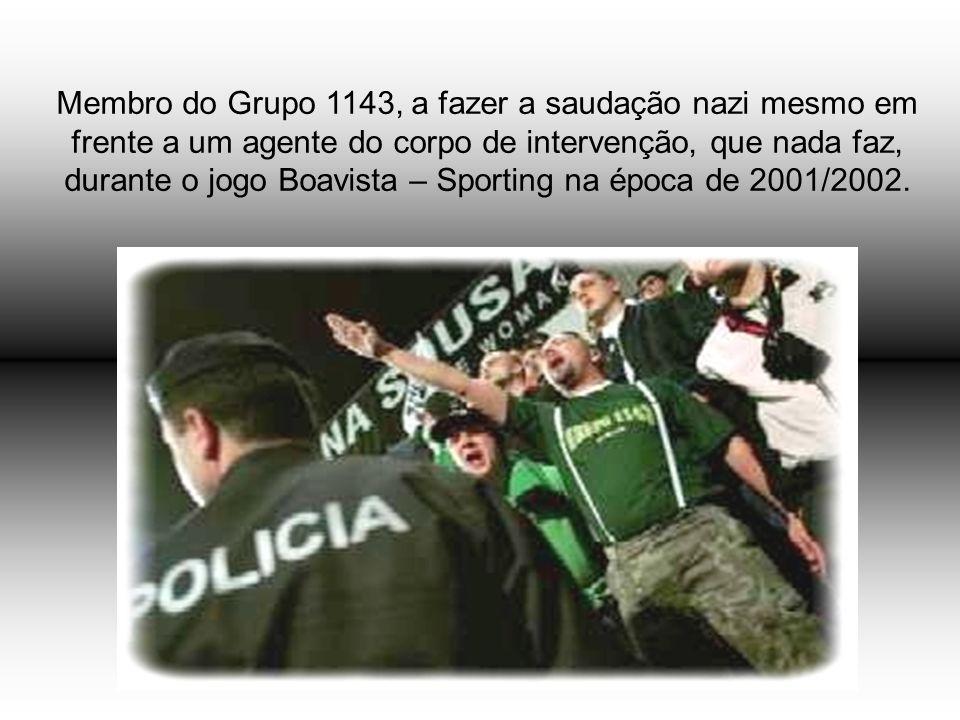 Membro do Grupo 1143, a fazer a saudação nazi mesmo em frente a um agente do corpo de intervenção, que nada faz, durante o jogo Boavista – Sporting na