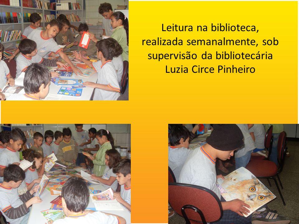 Leitura na biblioteca, realizada semanalmente, sob supervisão da bibliotecária Luzia Circe Pinheiro