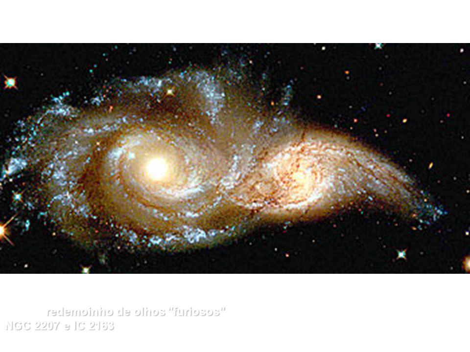 [9] Um redemoinho de olhos furiosos furiosos de duas galáxias, que se fundem, chamadas NGC 2207 e IC 2163 2163, distantes 114 milhões de anos luz na distante Constelação do Cão Maior (Canis Major).