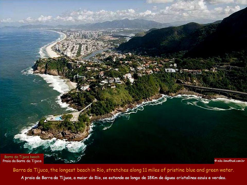 Barra da Tijuca, the longest beach in Rio, stretches along 11 miles of pristine blue and green water.