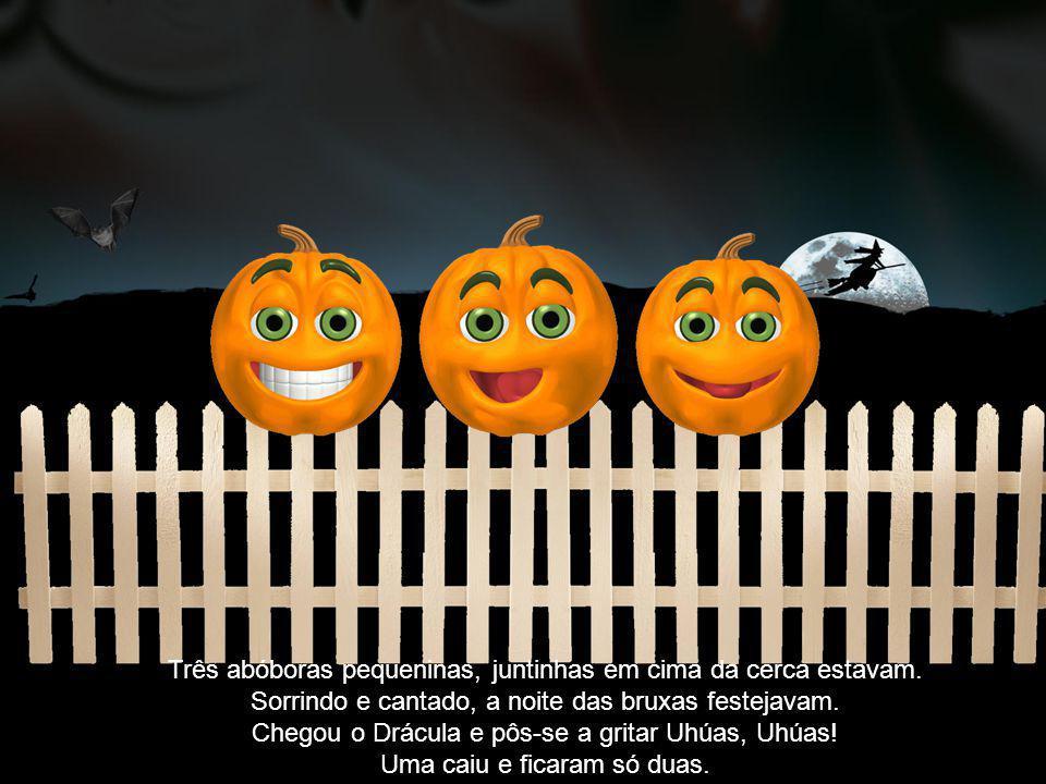 Duas abóboras pequeninas em cima da cerca estavam Sorrindo e cantado, a noite das bruxas festejavam.