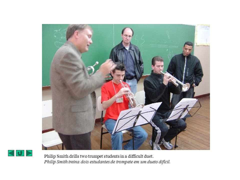 Philip Smith drills two trumpet students in a difficult duet.