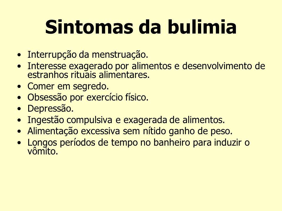 Sintomas da bulimia Interrupção da menstruação. Interesse exagerado por alimentos e desenvolvimento de estranhos rituais alimentares. Comer em segredo