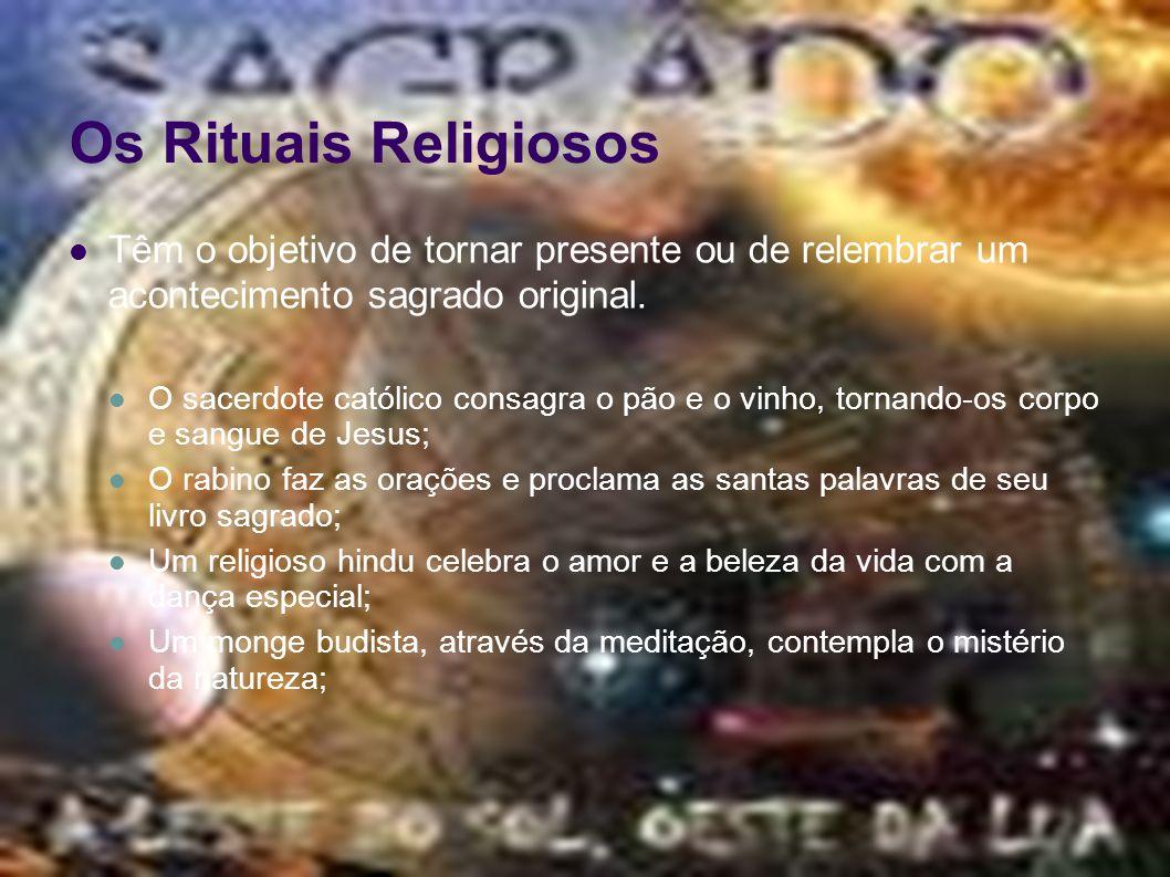 Os Rituais Religiosos Têm o objetivo de tornar presente ou de relembrar um acontecimento sagrado original. O sacerdote católico consagra o pão e o vin