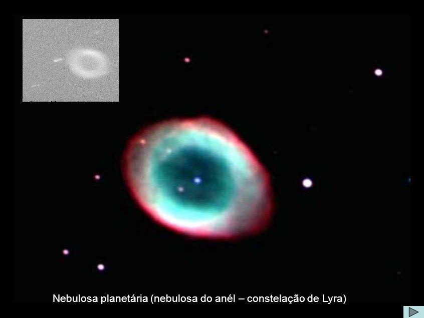 Nebulosa do Anel Comentário: Exceto pelos anéis de Saturno, a Nebulosa do Anel (M57) é provavelmente o mais famoso aro celestial.