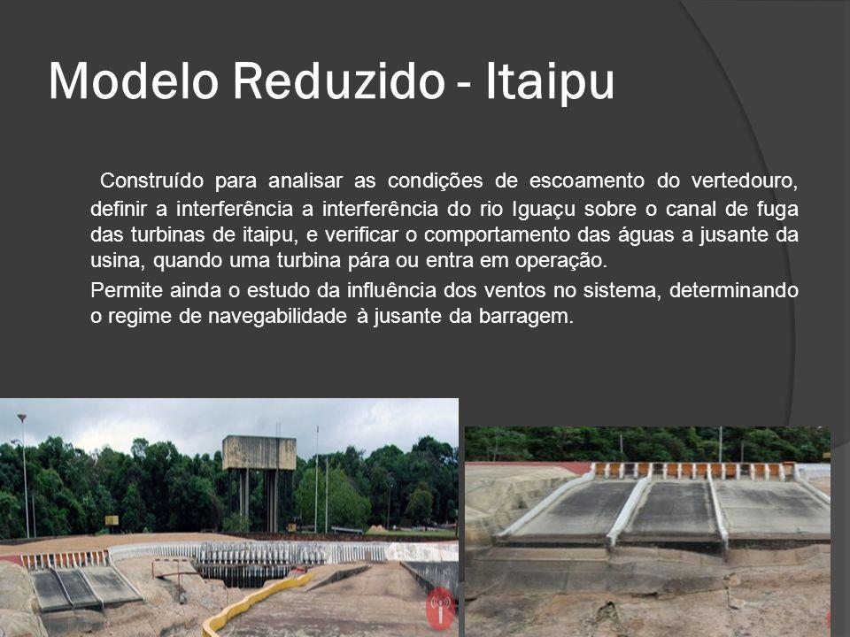Modelo Reduzido - Itaipu Construído para analisar as condições de escoamento do vertedouro, definir a interferência a interferência do rio Iguaçu sobr