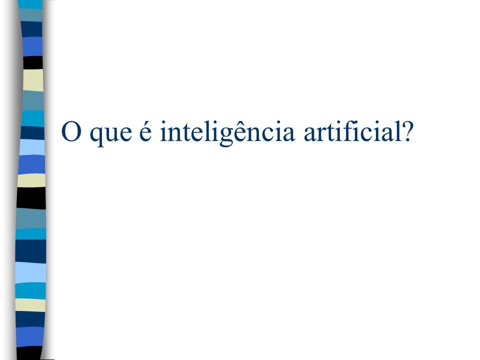 Barr & Feigenbaum (1981) n IA é a parte da ciência da computação que se preocupa em desenvolver sistemas computacionais inteligentes, isto é, sistemas que exibem características, as quais nós associamos com a inteligência no comportamento humano - por exemplo, compreensão da linguagem, aprendizado, raciocínio, resolução de problemas, etc.