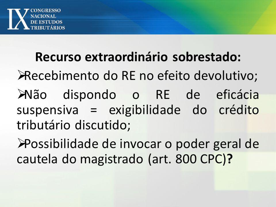 Recurso extraordinário sobrestado: Recebimento do RE no efeito devolutivo; Não dispondo o RE de eficácia suspensiva = exigibilidade do crédito tributá