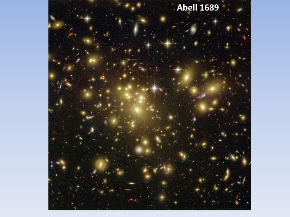 Aglomerados de Galáxias (ou de ME?) Os maiores sistems gravitacionalmente conectados no Universo.