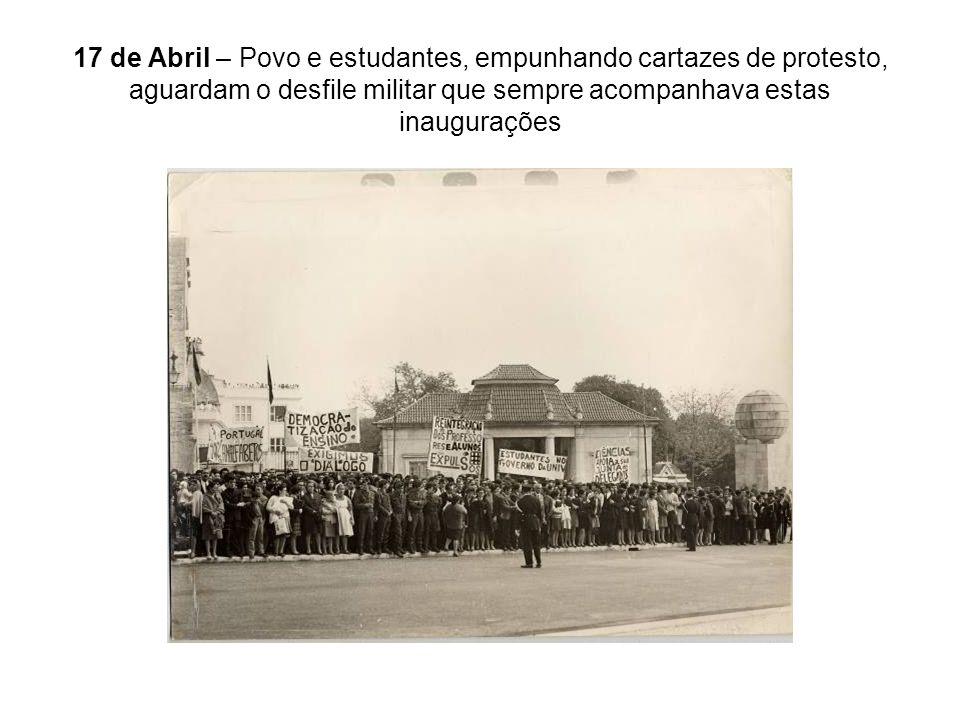 17 de Abril – Povo e estudantes, empunhando cartazes de protesto, aguardam o desfile militar que sempre acompanhava estas inaugurações