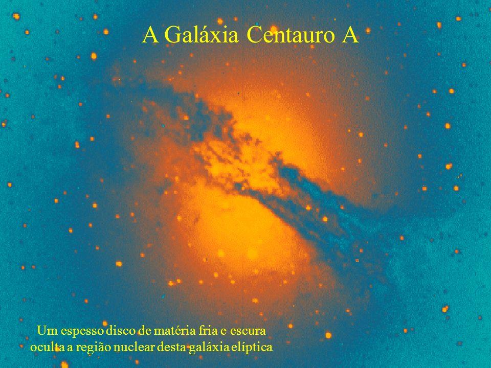 A Galáxia Centauro A Um espesso disco de matéria fria e escura oculta a região nuclear desta galáxia elíptica