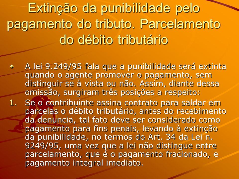 Extinção da punibilidade pelo pagamento do tributo. Parcelamento do débito tributário A lei 9.249/95 fala que a punibilidade será extinta quando o age