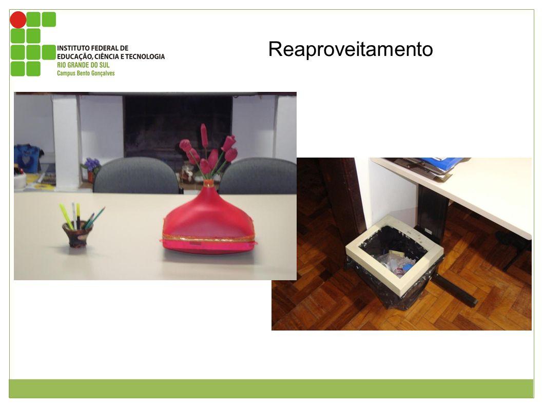 Reaproveitamento Figura 1: Vaso feito apartir do tubo de imagem do monitor. Este foi pintado de rosa, possui fitas douradas em sua base e gargalo está