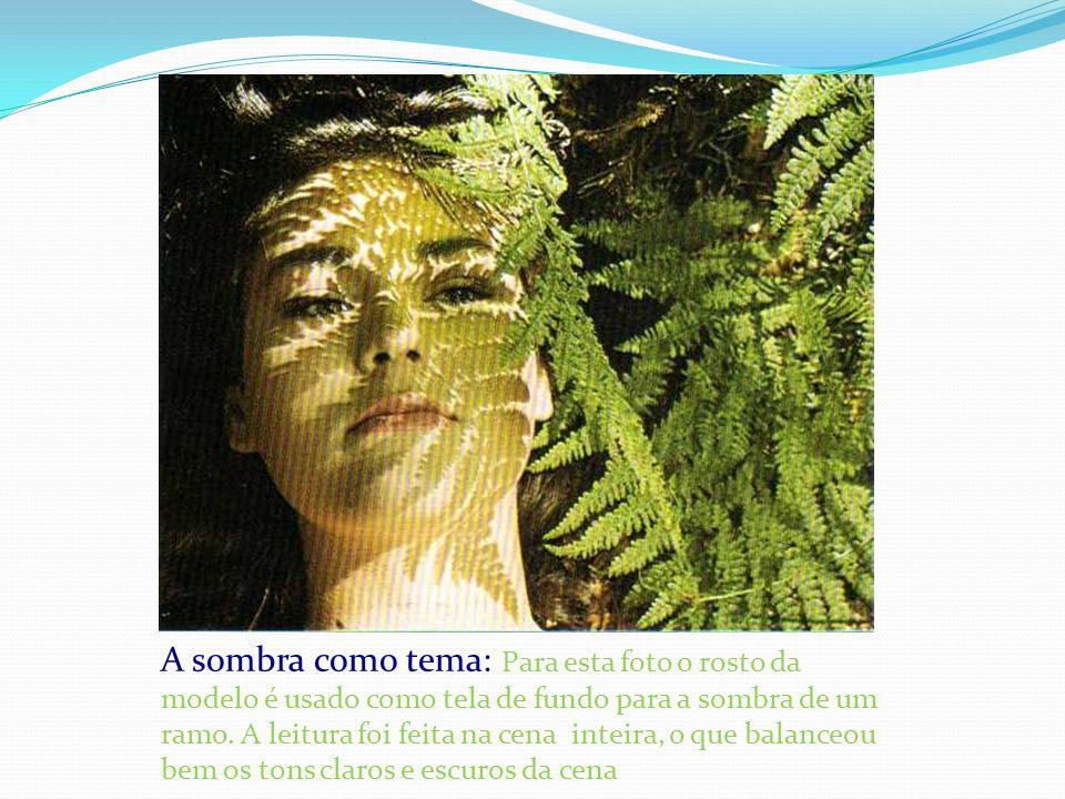 A sombra como tema: Para esta foto o rosto da modelo é usado como tela de fundo para a sombra de um ramo. A leitura foi feita na cena inteira, o que b