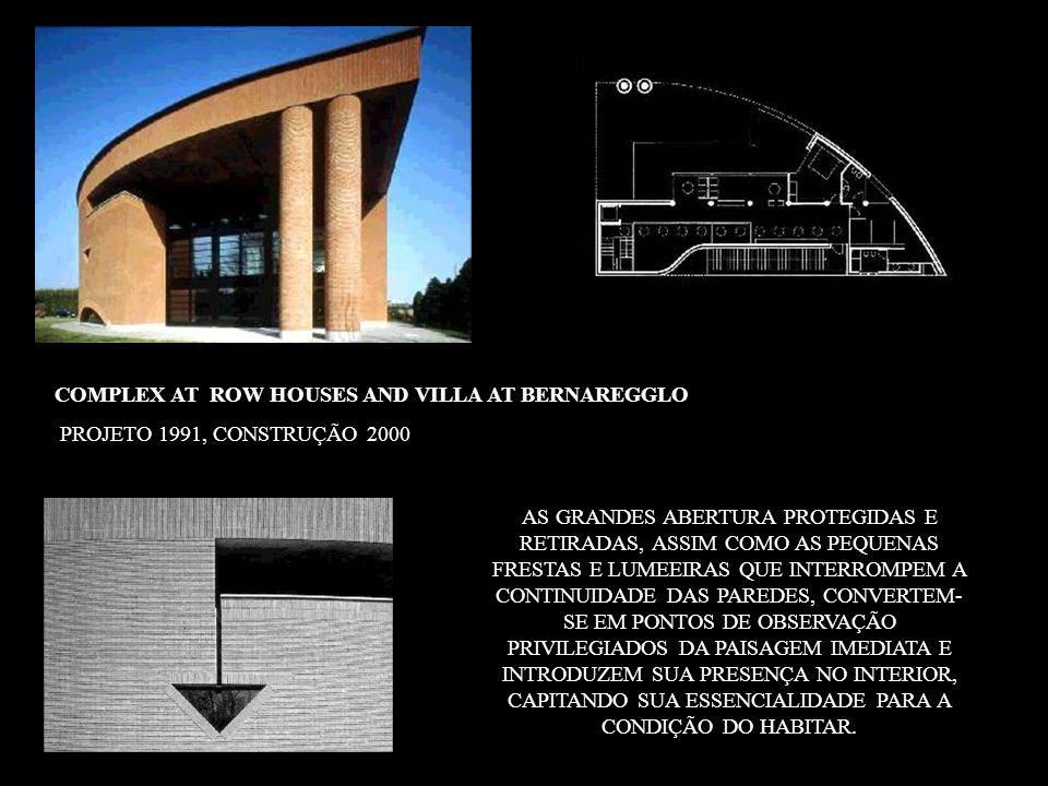RESIDENCES IN MONTE CARASSO - TICINO PROJETO 1992, CONSTRUÇÃO 1996 VISTAS DE LONGE, AS LINHAS GEOMÉTRICAS QUE SEPARAM DE MANEIRA NÍTIDA OS VOLUMES PRIMÁRIOS, RECORTANDO OS CONTORNOS DO EDIFÍCIO CONTRA O FUNDO DE UMA PAISAGEM NATURAL SINGULAR, ADVERTEM-NOS DE UMA PRESENÇA INSÓLITA QUE, NO ENTANTO, PARECE ARRAIGADA DESDE SEMPRE NAQUELE LUGAR, DESAFIANDO O TEMPO E O CONTÁGIO COM UMA HUMANIZAÇÃO DO TERRITÓRIO CADA VEZ MAIS INÁBIL E EVENTUAL.