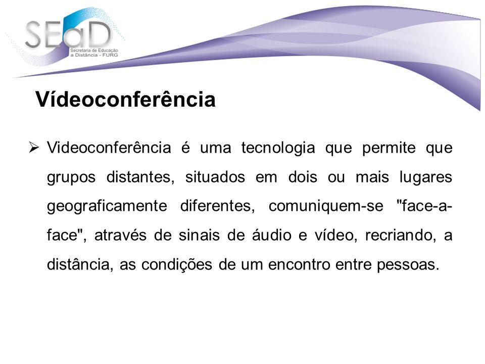 Videoconferência é uma tecnologia que permite que grupos distantes, situados em dois ou mais lugares geograficamente diferentes, comuniquem-se face-a- face , através de sinais de áudio e vídeo, recriando, a distância, as condições de um encontro entre pessoas.