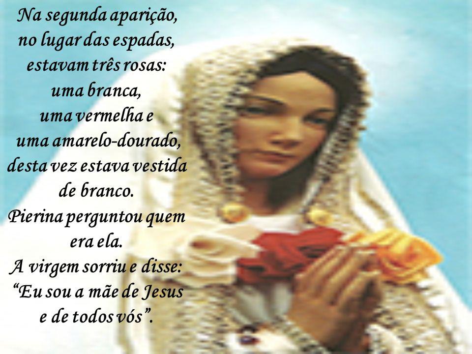 Na segunda aparição, no lugar das espadas, estavam três rosas: uma branca, uma vermelha e uma amarelo-dourado, desta vez estava vestida de branco.
