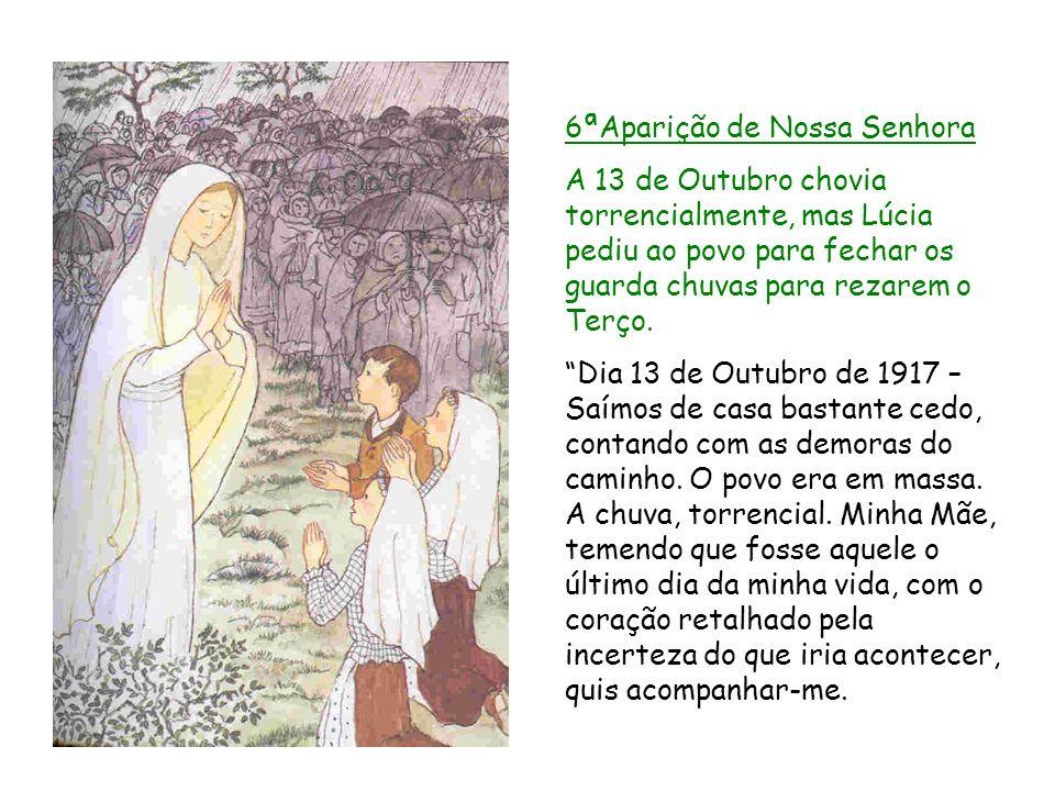 6ªAparição de Nossa Senhora A 13 de Outubro chovia torrencialmente, mas Lúcia pediu ao povo para fechar os guarda chuvas para rezarem o Terço. Dia 13