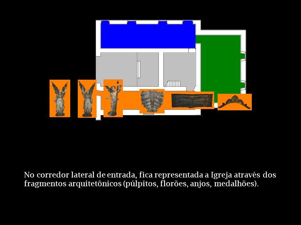 No corredor lateral de entrada, fica representada a Igreja através dos fragmentos arquitetônicos (púlpitos, florões, anjos, medalhões).