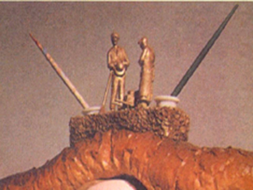 Pão e tinteiro, porcelana, espiga de milho, formiga e tira zootrópica sobre cartão. Bélgica, Coleção Particular