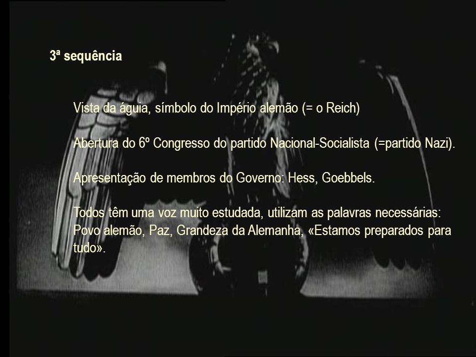 3ª sequência Vista da águia, símbolo do Império alemão (= o Reich) Abertura do 6º Congresso do partido Nacional-Socialista (=partido Nazi). Apresentaç