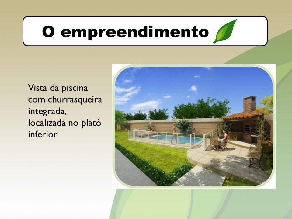 DIVIDIR O LAZER COM VÁRIAS IMAGENS EM 2 SLIDES empreendimento Vista da piscina com churrasqueira integrada, localizada no platô inferior O empreendimento