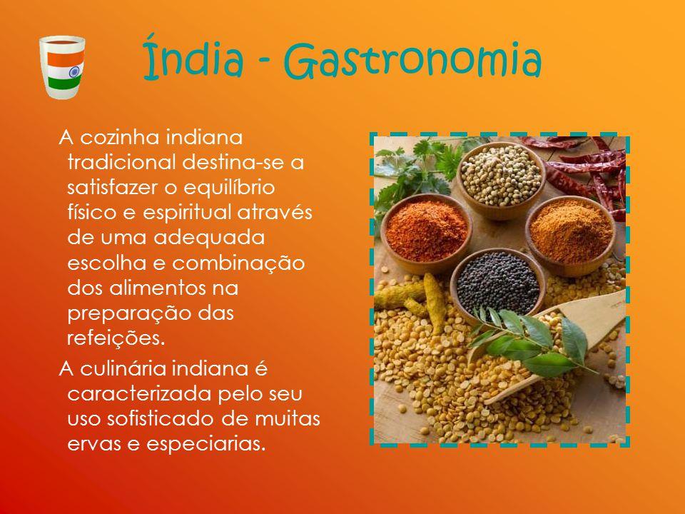 Índia - Gastronomia A cozinha indiana tradicional destina-se a satisfazer o equilíbrio físico e espiritual através de uma adequada escolha e combinaçã