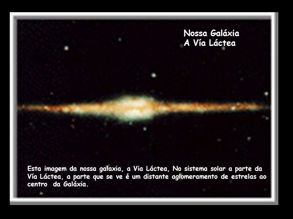 Nossa Galáxia A Vía Láctea Esta imagem da nossa galaxia, a Via Láctea, No sistema solar a parte da Vía Láctea, a parte que se ve é um distante aglomer