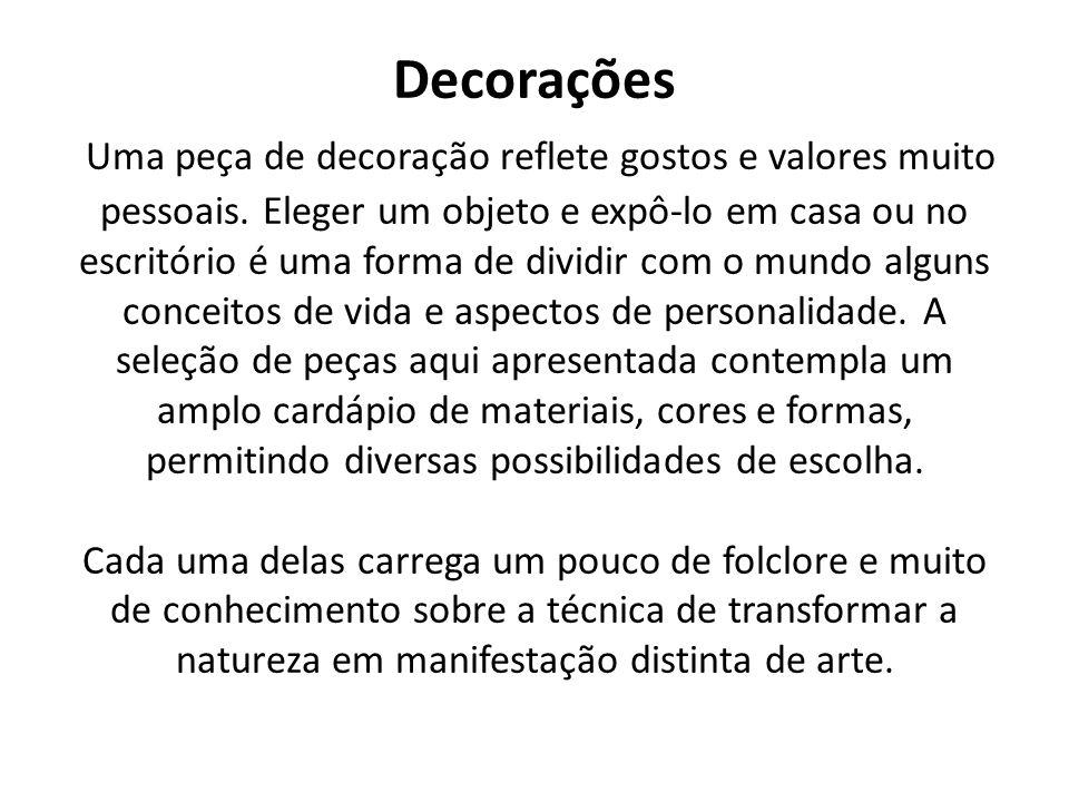 Categoria: Souvenirs Produto: Porta chaves Artesã: Ines Souza Menezes Araujo Idade: 69 anos Bairro: Jacaraípe Produção mensal: 100 Matéria Prima: Madeira e semente.