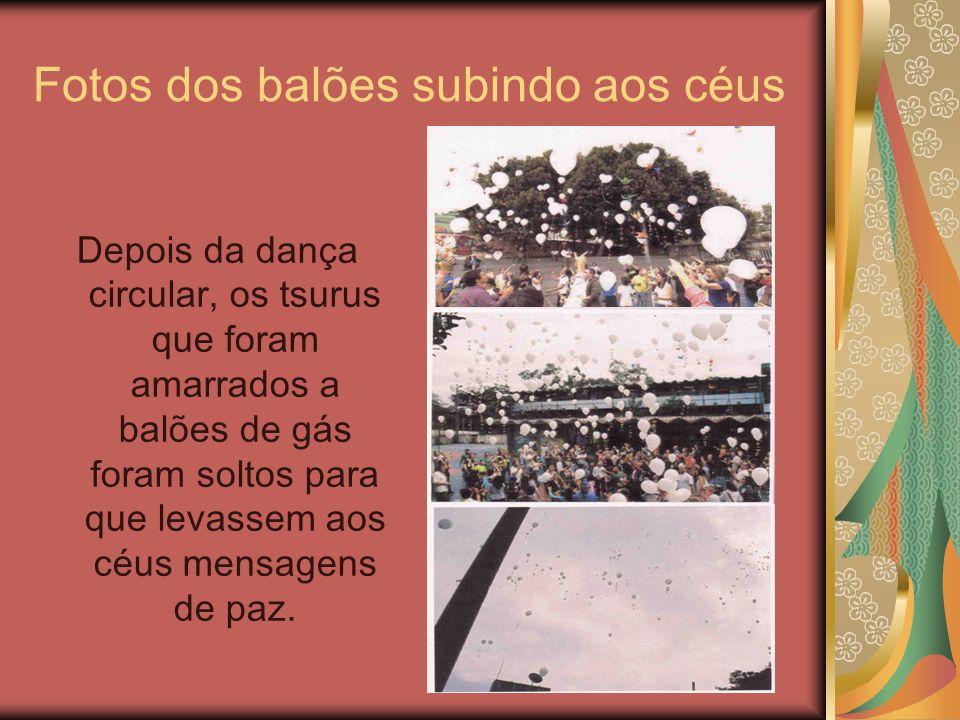 Fotos dos balões subindo aos céus Depois da dança circular, os tsurus que foram amarrados a balões de gás foram soltos para que levassem aos céus mens