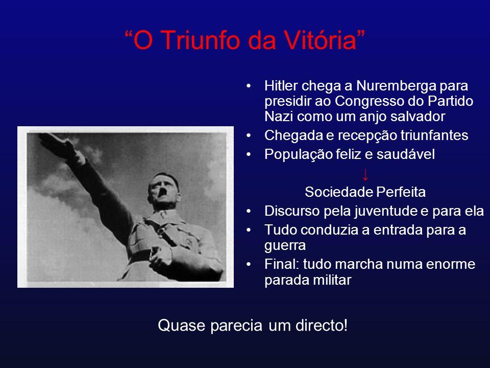 O Triunfo da Vitória Hitler chega a Nuremberga para presidir ao Congresso do Partido Nazi como um anjo salvador Chegada e recepção triunfantes Populaç