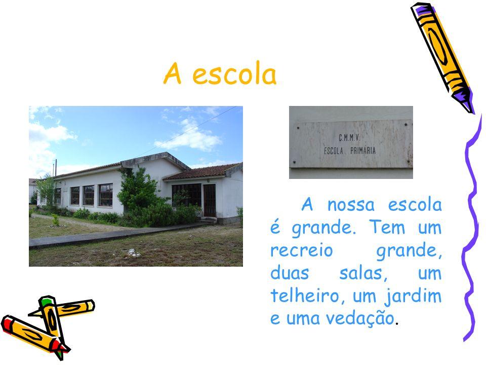A escola A nossa escola é grande. Tem um recreio grande, duas salas, um telheiro, um jardim e uma vedação.