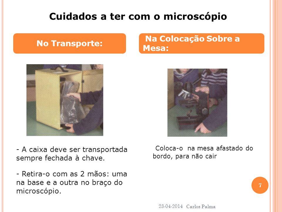 No Transporte: Na Colocação Sobre a Mesa: Cuidados a ter com o microscópio - A caixa deve ser transportada sempre fechada à chave. - Retira-o com as 2