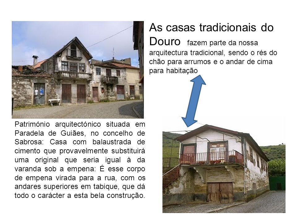 Património arquitectónico situada em Paradela de Guiães, no concelho de Sabrosa: Casa com balaustrada de cimento que provavelmente substituirá uma ori