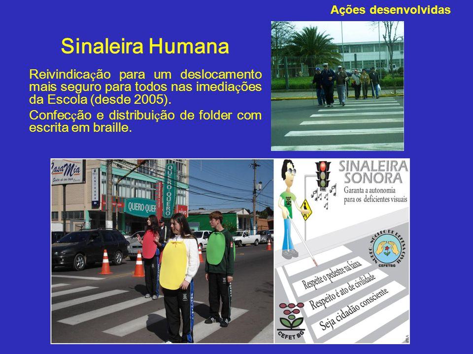 Sinaleira Humana Reivindica ç ão para um deslocamento mais seguro para todos nas imedia ç ões da Escola (desde 2005). Confec ç ão e distribui ç ão de