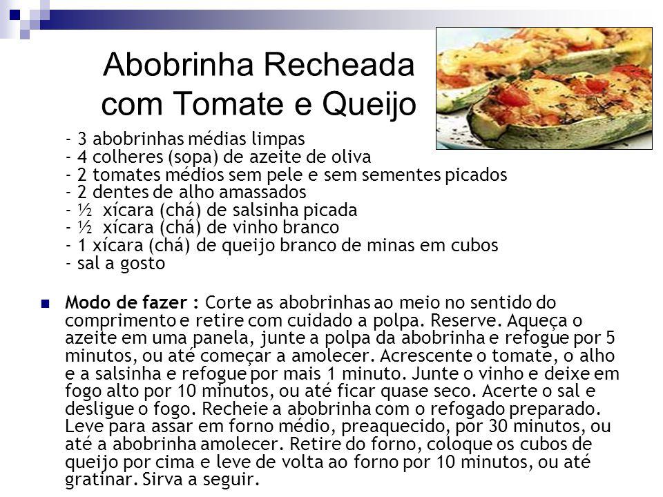 Abobrinha Recheada com Tomate e Queijo - 3 abobrinhas médias limpas - 4 colheres (sopa) de azeite de oliva - 2 tomates médios sem pele e sem sementes