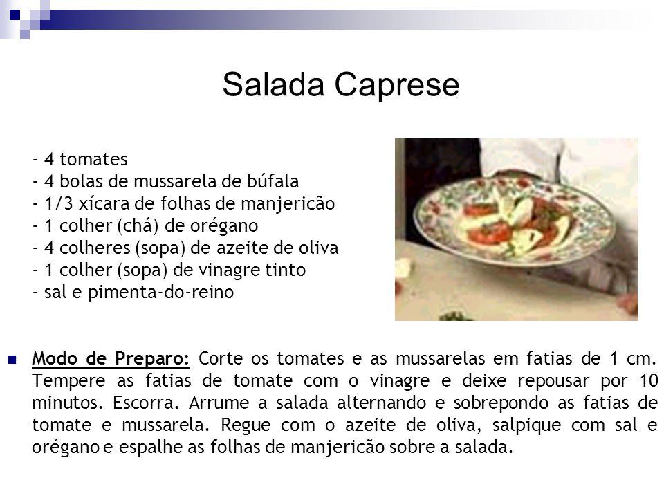 Salada Caprese - 4 tomates - 4 bolas de mussarela de búfala - 1/3 xícara de folhas de manjericão - 1 colher (chá) de orégano - 4 colheres (sopa) de az