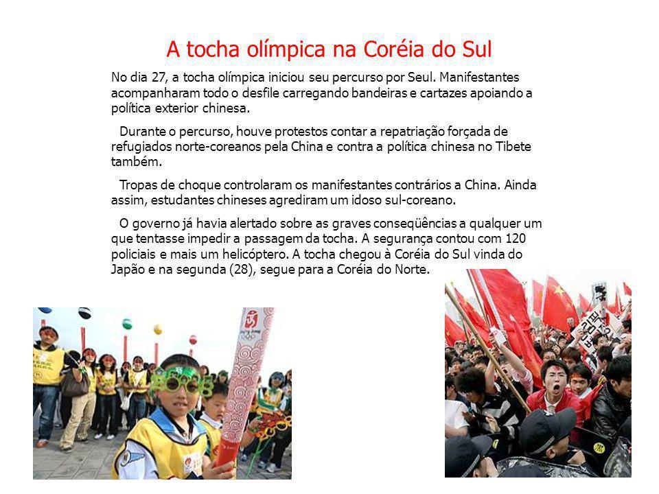 A tocha olímpica na Coréia do Sul No dia 27, a tocha olímpica iniciou seu percurso por Seul. Manifestantes acompanharam todo o desfile carregando band