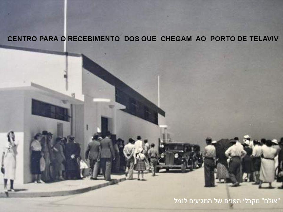 העמסת תיבות תפוזים בנמל תל אביב TRANSPORTE DE CAIXAS DE LARANJAS NAS DOCAS DO PORTO DE TEL-AVIV