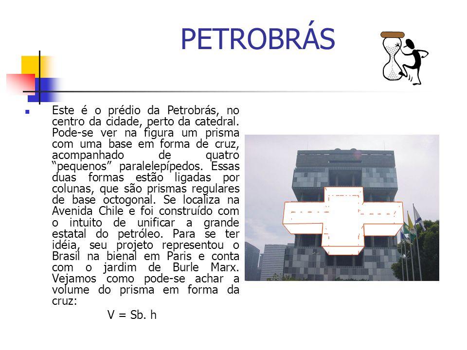 PETROBRÁS Este é o prédio da Petrobrás, no centro da cidade, perto da catedral. Pode-se ver na figura um prisma com uma base em forma de cruz, acompan