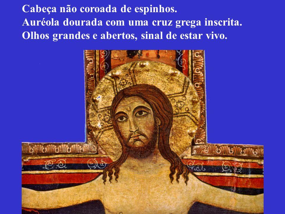 Cabeça não coroada de espinhos. Auréola dourada com uma cruz grega inscrita. Olhos grandes e abertos, sinal de estar vivo.