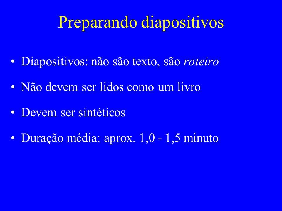 Preparando diapositivos Diapositivos: não são texto, são roteiro Não devem ser lidos como um livro Devem ser sintéticos Duração média: aprox. 1,0 - 1,