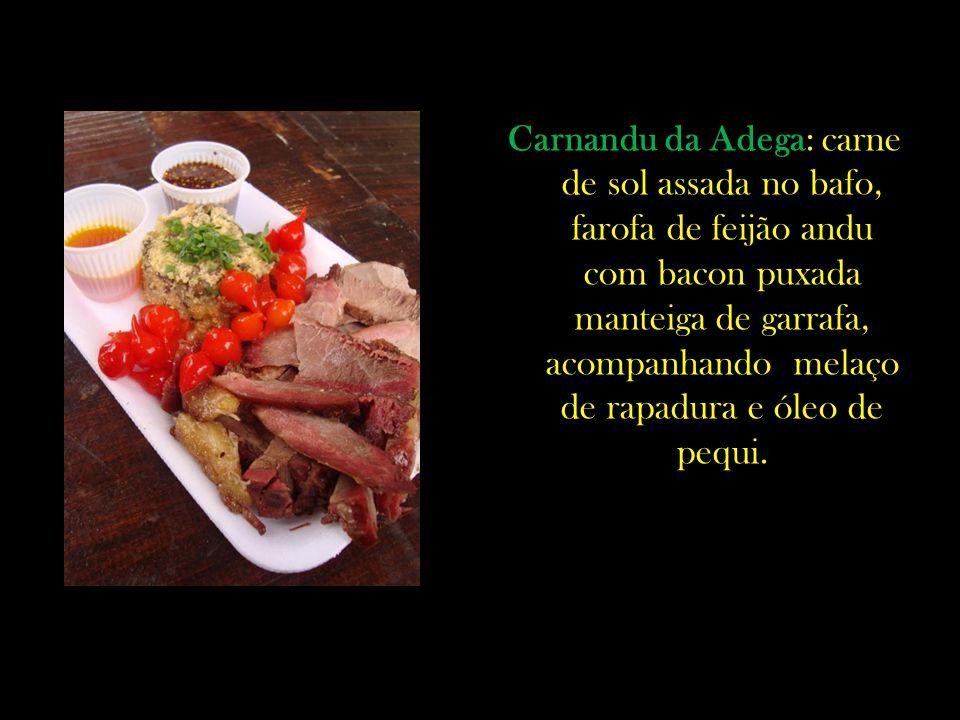 Carnandu da Adega: carne de sol assada no bafo, farofa de feijão andu com bacon puxada manteiga de garrafa, acompanhando melaço de rapadura e óleo de