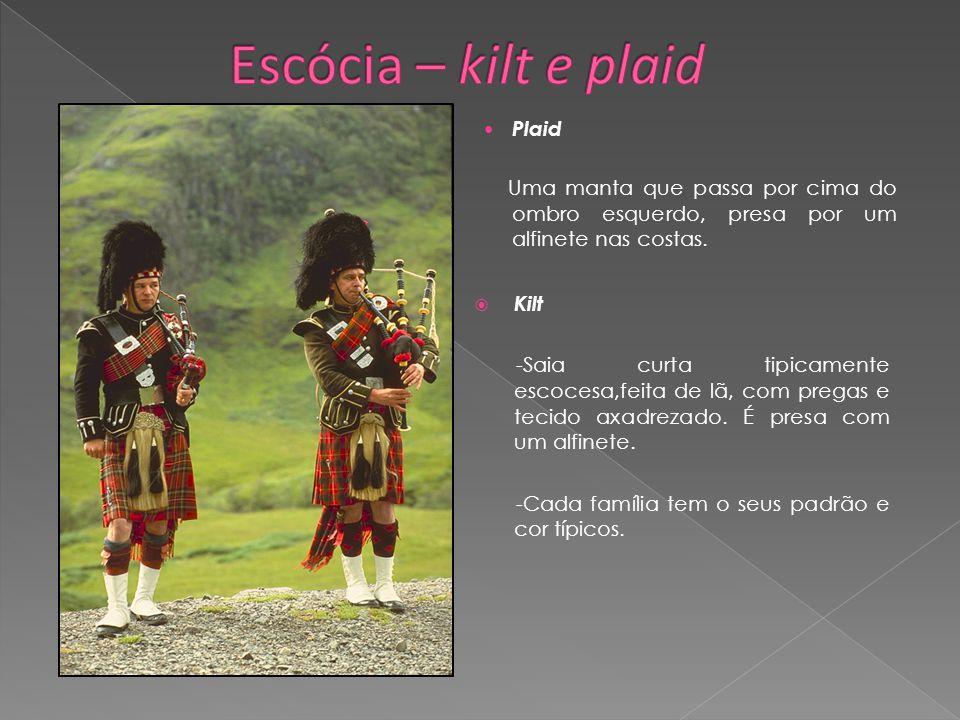 Kilt -Saia curta tipicamente escocesa,feita de lã, com pregas e tecido axadrezado. É presa com um alfinete. -Cada família tem o seus padrão e cor típi