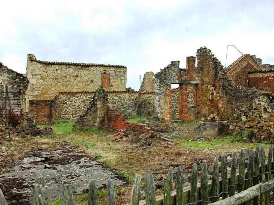 Outros massacres Os SS inspeccionam de novo as casas da aldeia; eles matam todos os habitantes que tinham podido escapar nas suas primeiras buscas, em