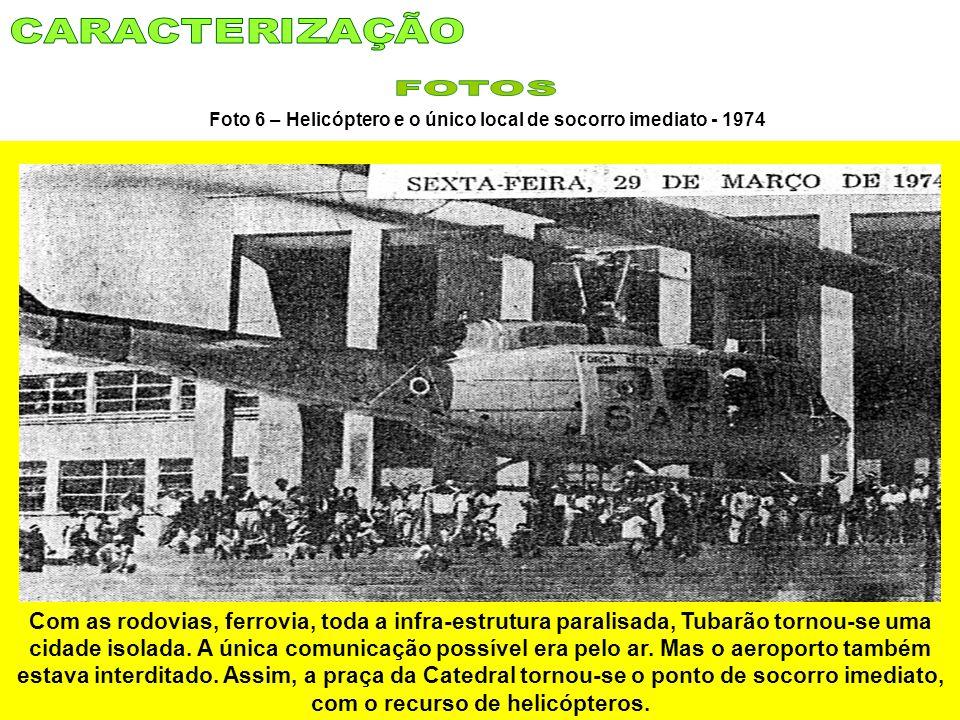 Foto 6 – Helicóptero e o único local de socorro imediato - 1974 Com as rodovias, ferrovia, toda a infra-estrutura paralisada, Tubarão tornou-se uma ci