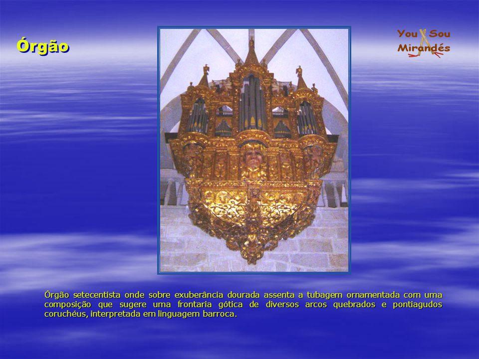 Órgão setecentista onde sobre exuberância dourada assenta a tubagem ornamentada com uma composição que sugere uma frontaria gótica de diversos arcos q