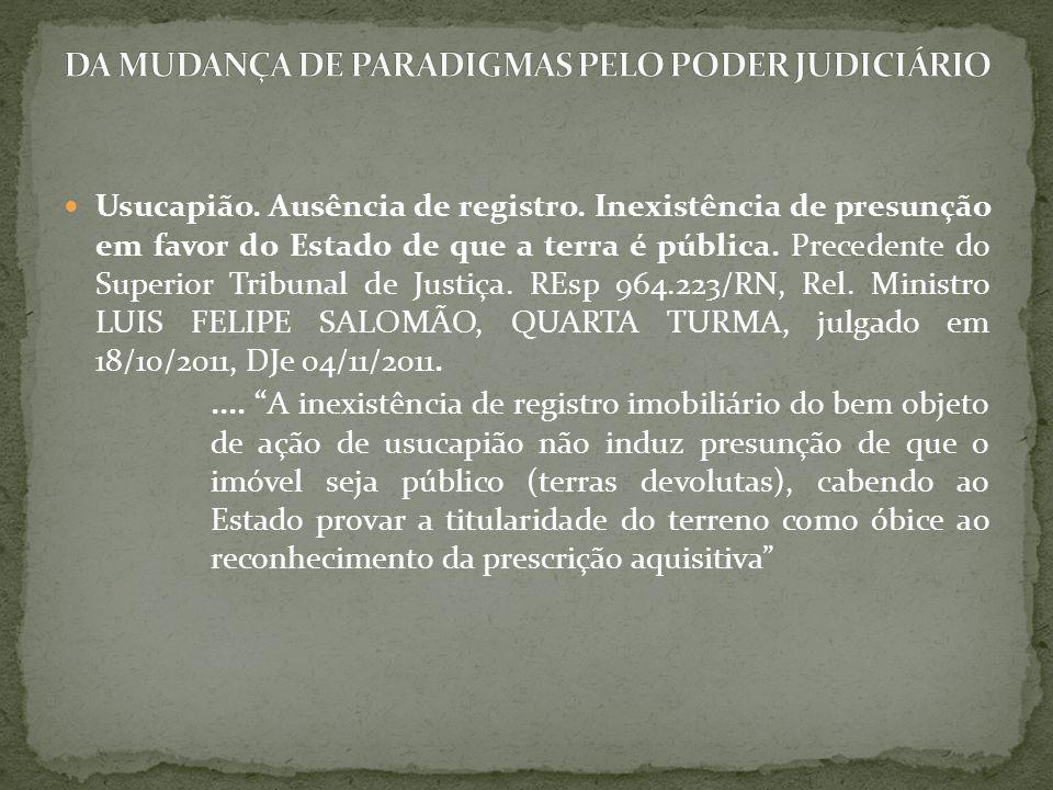 Usucapião. Ausência de registro. Inexistência de presunção em favor do Estado de que a terra é pública. Precedente do Superior Tribunal de Justiça. RE